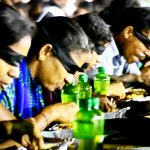 BLINDFOLDED MOST PEOPLE EATING BIRIYANI TOGETHER